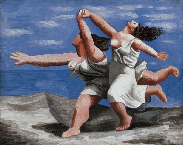 Mujeres corriendo en la playa
